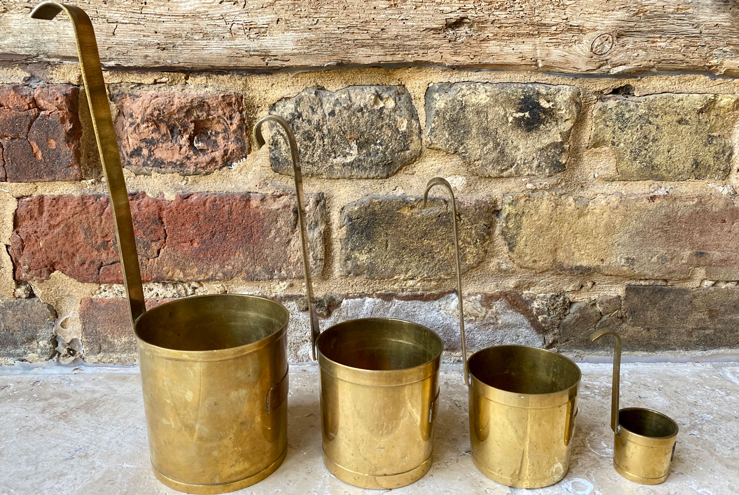 vintage french mid century brass measuring cups