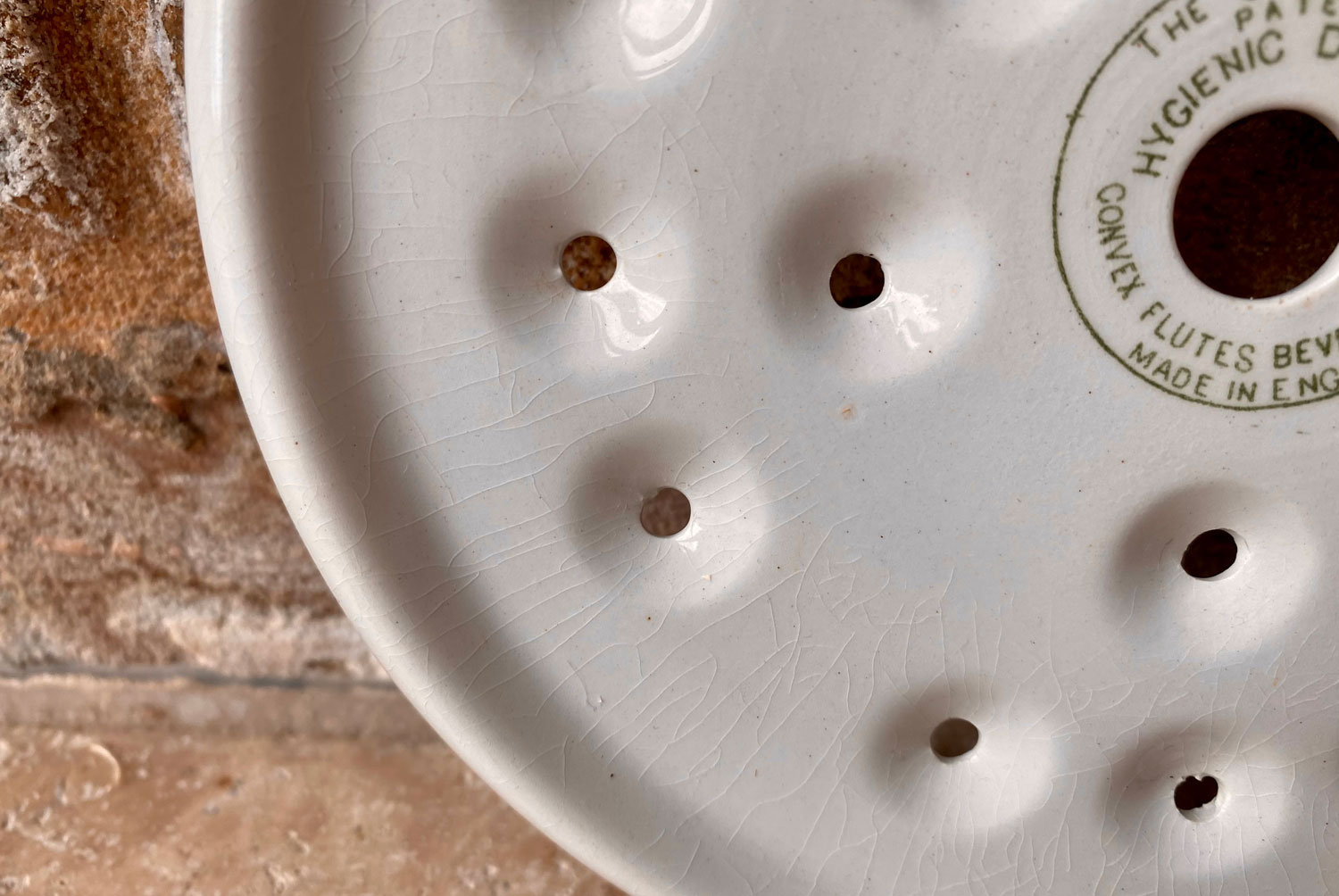antique rare 1920s grimwades household drainer small circular plate
